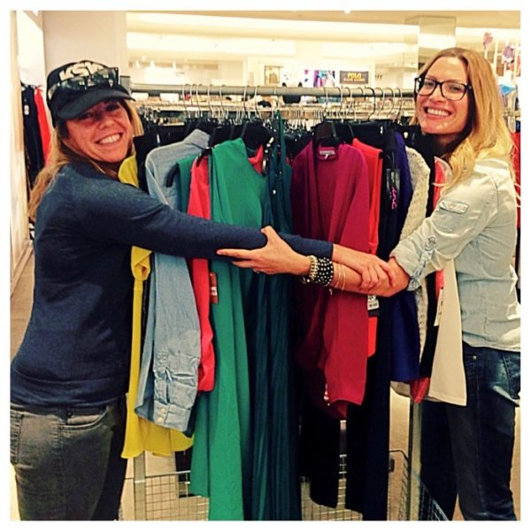 Client Pam and Rayne Parvis, personal stylist posing with a rack full of purchases at Macy's in Sherman Oaks, CA.